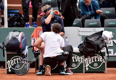 Victoria Azarenka of Belarus Gets Medical Assistance As She Plays Karin Knapp of Italy During Their Women's Single First Round Match at the French Open Tennis Tournament at Roland Garros in Paris France 24 May 2016 France Paris