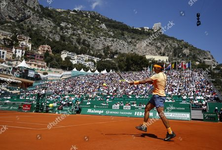 Rafael Nadal of Spain Returns the Ball to Alijaz Bedene of Great Britain During Their Second Round Match at the Monte-carlo Rolex Masters Tennis Tournament in Roquebrune Cap Martin France 13 April 2016 France Roquebrune Cap Martin