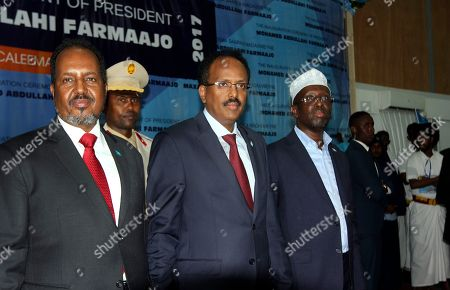 "Mohamed Abdullahi Mohamed, Hassan Sheikh Mohamud, Sharif Sheikh Ahmed Somalia's President Mohamed Abdullahi Mohamed, also known as Farmajo, center, is accompanied by two former presidents Hassan Sheikh Mohamud, left, and Sharif Sheikh Ahmed, right, at his inauguration ceremony in Mogadishu, Somalia . Somalia's new leader, who also holds U.S. citizenship, was inaugurated Wednesday while promising to restore dignity to the troubled Horn of Africa nation but warning it will take another two decades to ""fix"" the country"