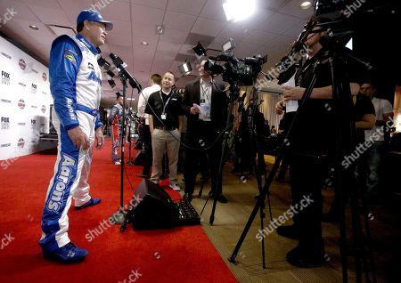 Michael Waltrip speaks with reporters at NASCAR Daytona 500 media day at Daytona International Speedway, in Daytona Beach, Fla