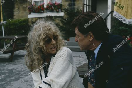 Coral Atkins (as Ruth Jamieson) and Norman Bowler (as Frank Tate) as Frank has a drink with his old friend Ruth, outside the Woolpack (Ep 1801 - 21st September 1993)