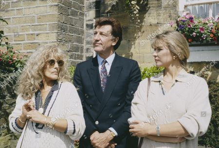Coral Atkins (as Ruth Jamieson) and Norman Bowler (as Frank Tate) as Frank has a drink with his old friend Ruth, and his pleased to introducer her to a surprised Kim, as played by Claire King (Ep 1801 - 21st September 1993)