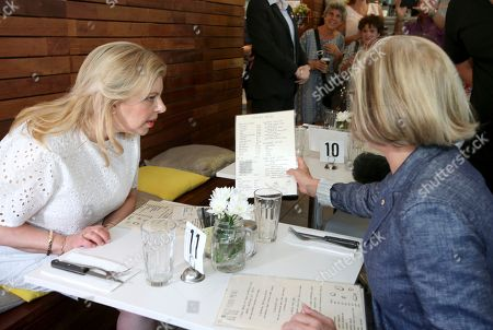 Stock Photo of Lucy Turnbull, Lara Netanyahu Lara Netanyahu, left, the wife of Israeli Prime Minister Benjamin Netanyahu, and Lucy Turnbull, right, the wife of Australia's Prime Minister Malcolm Turnbull, look at a menu as they sit together at a cafe in Sydney, . Prime Ministers Netanyahu and Turnbull signed agreements on technology and air services as well as discussed expanding co-operation in areas, including cyber-security, innovation and science