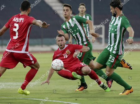 Dalibor Volas (c) of Fk Partizani in Action Against Marco Djuricin (r) and Zoltan Gera (2-r) of Ferencvaros During the Uefa Champions League Second Qualifying Round First Leg Soccer Match Between Fk Partizani and Ferencvaros in Elbasan Albania 13 July 2016 Albania Elbasan