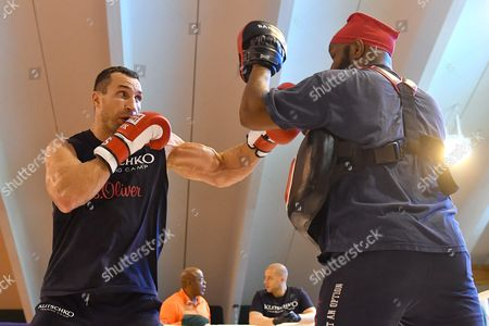 Ukrainian Boxer Vladimir Klitschko (l) Sparring with His Coach Johnathon Banks at a Training Camp in the Indoor Tennis Centre of the Hotel Stanglwirt in Going in Austria 23 June 2016 Ibf Ibo and Wbo World Boxing Champion Klitschko Will Compete Against British Tyson Fury on 09 July 2016 Austria Going