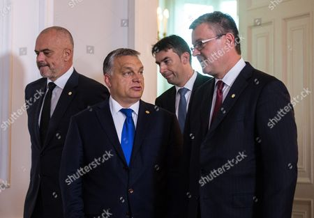 (l-r) Albanian Prime Minister Edi Rama Hungarian Prime Minister Viktor Orban Romanian Interior Minister Dragos Tudorache and Croatian Prime Minister Tihomir Oreskovic Arrive For a Group Photo Call During the Summit 'Migration Along the Balkan Route' in Vienna Austria 24 September 2016 Austrian Chancellor Christian Kern Invited Heads of Government of Albania Bulgaria Germany Greece Croatia Fyrom (former Yugoslav Republic of Macedonia) Serbia Slovenia Hungary the President of the European Council the European Commissioner For Migration and Interior Minister of Romania to Discus a Common Strategy For the Migrants Situation Along the Balkan Route Austria Vienna