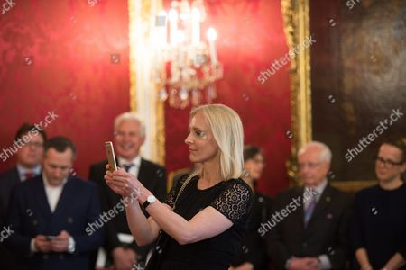 Austrian Chancellor Christian Kern's Wife Eveline Steinberger Kern Takes a Photograph During Kern's Inauguration in Vienna Austria 17 May 2016 Christian Kern Has Repleced Former Austrian Chancellor Werner Faymann Austria Vienna