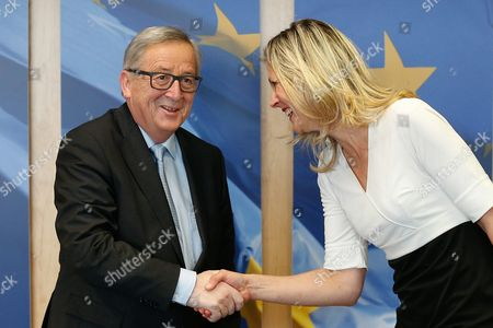 Stock Photo of German Eu Deputy Silvana Koch-mehrin (r) is Welcomed by the President of the European Commission Jean-claude Juncker at the European Commission in Brussels Belgium 10 March 2016 Belgium Brussels