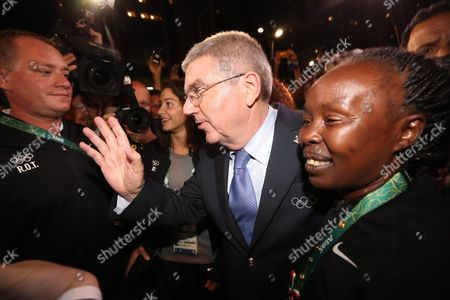 Ioc President Thomas Bach (c) Talks to Members of the Refugee Olympic Athletes (roa) Delegation Including Chef De Mission For Olympics Refugees Tegla Loroupe (r) of Kenya During the Team Welcome Ceremony For the Refugee Olympic Team at Olympic Park Village Prior to the Rio 2016 Olympic Games in Rio De Janeiro Brazil 03 August 2016 Ten Refugee Athletes Including Two Syrian Swimmers Will Form a Team Set to Compete in the Rio 2016 Olympics Rio 2016 Olympic Games Take Place From 05 to 21 August Brazil Rio De Janeiro