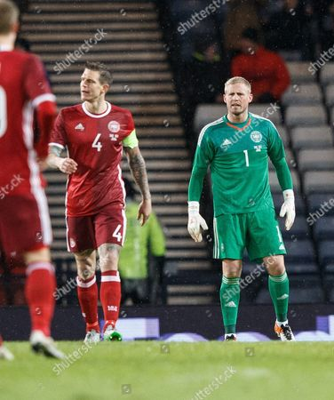 A Disagreement Between Daniel Agger of Denmark (l) and Keeper Kasper Schmeichel of Denmark During the International Soccer Friendly Match Between Scotland V Denmark at Hampden Park Glasgow Scotland Britain 29 March 2016 United Kingdom Glasgow