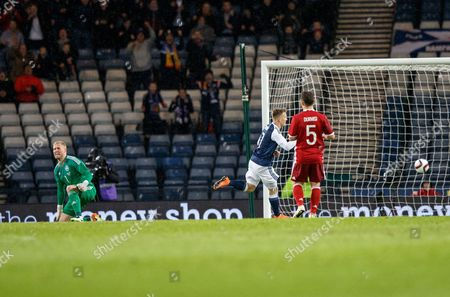 Matt Ritchie of Scotland (2r) Scores After a Mix Up Between Daniel Agger of Denmark (l) and Keeper Kasper Schmeichel of Denmark During the International Soccer Friendly Match Between Scotland V Denmark at Hampden Park Glasgow Scotland Britain 29 March 2016 United Kingdom Glasgow