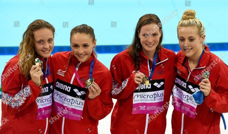 Britain's (l-r) Francesca Halsall Chloe Tutton Kathleen Dawson and Siobhan Marie O'connor Pose with Their Gold Medals After Winning the Women's 4x100m Medley Relay Final at the Len European Aquatics Championships 2016 in London Britain 22 May 2016 United Kingdom London