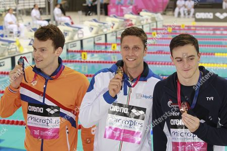 Gold Medal Winner Luca Dotto From Italy (c) is Flanked by Silver Medalist Sebastiaan Verschuren From the Netherlands (l) and Bronze Medalist Clement Mignon From France (r) As They Pose with Their Medals After the Men's 100 M Freestyle Final at the Len European Aquatics Championships 2016 in London Britain 20 May 2016 United Kingdom London