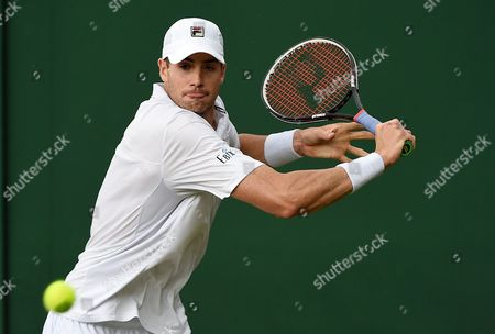 John Isner of the Usa Returns to Matthew Barton of Australia During Their Second Round Match at the Wimbledon Championships at the All England Lawn Tennis Club in London Britain 1 July 2016 United Kingdom Wimbledon