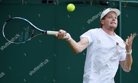 Matthew Barton of Australia Returns to John Isner of the Usa During Their Second Round Match at the Wimbledon Championships at the All England Lawn Tennis Club in London Britain 1 July 2016 United Kingdom Wimbledon