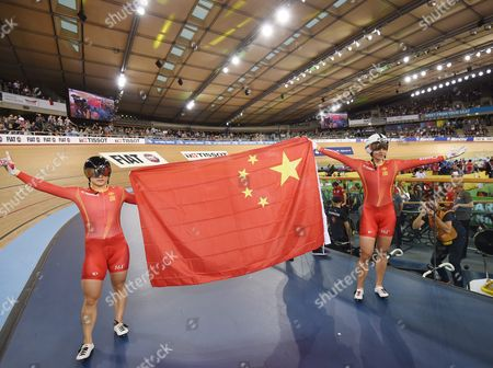 Stock Photo of Tianshi Zhong (l) and Lin Junhong (r) of China Celebrate After Winning Gold and Silver Medals in the Womens Sprint at the 2016 Uci Track Cycling World Championships in London Britain 06 March 2016 United Kingdom London