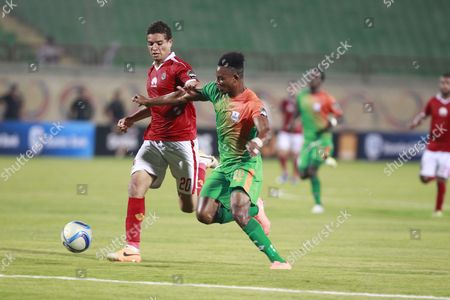 Al Ahly's Player Saad Samir (l) in Action Against Zesco United Player John Ching'andu (r) During the African Champions League (caf) Grou Stage Match Between Al Ahly and Zesco United at Military Stadium in Suez Egypt 12 August 2016 Egypt Suez
