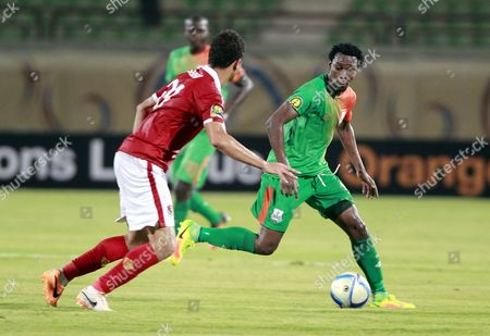 Al Ahly's Player Saad Samir (l) in Action Against Zesco United Player John Ching'andu (r) During the African Champions League (caf) Group Stage Match Between Al Ahly and Zesco United at Military Stadium in Suez Egypt 12 August 2016 Egypt Suez