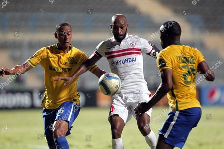 Zamalek's Player Shikabala (c) in Action Against Sundowns Player Siyanda Zwane (r) and Wayne Arendse (l) During the African Champions League (caf) Group Stage Soccer Match Between Zamalek's and Sundowns at Petro Sport Stadium in Cairo Egypt 17 July 2016 Egypt Cairo