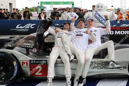 Porsche Team Ní2 with Romain Dumas (c) of France Neel Jani (l) of Switzerland and Marc Lieb (r) of Germany Celebrate Their Victory Before the Podium Ceremony of the Le Mans 24 Hours Race in Le Mans France 19 June 2016 France Le Mans
