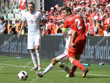 Slawomir Peszko of Poland (2-r) in Action Against Stephan Lichtsteiner (r) of Switzerland During the Uefa Euro 2016 Round of 16 Match Between Switzerland and Poland at Stade Geoffroy Guichard in Saint-etienne France 25 June 2016 (restrictions Apply: For Editorial News Reporting Purposes Only not Used For Commercial Or Marketing Purposes Without Prior Written Approval of Uefa Images Must Appear As Still Images and Must not Emulate Match Action Video Footage Photographs Published in Online Publications (whether Via the Internet Or Otherwise) Shall Have an Interval of at Least 20 Seconds Between the Posting ) France Saint-etienne