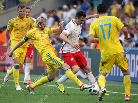 Anatoliy Tymoshchuk (2-l) of Ukraine in Action Against Tomasz Jodlowiec (2-r) of Poland During the Uefa Euro 2016 Group C Preliminary Round Match Between Ukraine and Poland at Stade Velodrome in Marseille France 21 June 2016 (restrictions Apply: For Editorial News Reporting Purposes Only not Used For Commercial Or Marketing Purposes Without Prior Written Approval of Uefa Images Must Appear As Still Images and Must not Emulate Match Action Video Footage Photographs Published in Online Publications (whether Via the Internet Or Otherwise) Shall Have an Interval of at Least 20 Seconds Between the Posting ) France Marseille