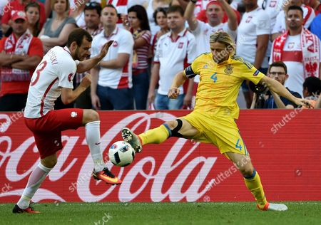 Filip Starzynski (l) of Poland and Anatoliy Tymoshchuk of Ukraine in Action During the Uefa Euro 2016 Group C Preliminary Round Match Between Ukraine and Poland at Stade Velodrome in Marseille France 21 June 2016 (restrictions Apply: For Editorial News Reporting Purposes Only not Used For Commercial Or Marketing Purposes Without Prior Written Approval of Uefa Images Must Appear As Still Images and Must not Emulate Match Action Video Footage Photographs Published in Online Publications (whether Via the Internet Or Otherwise) Shall Have an Interval of at Least 20 Seconds Between the Posting ) France Marseille