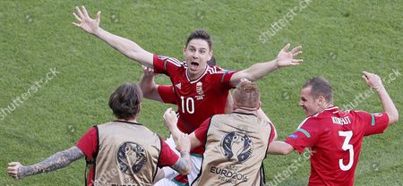 Zoltan Gera (c) of Hungary Celebrates with Teammates After Scoring the 1-0 Goal During the Uefa Euro 2016 Group F Preliminary Round Match Between Hungary and Portugal at Stade De Lyon in Lyon France 22 June 2016 (restrictions Apply: For Editorial News Reporting Purposes Only not Used For Commercial Or Marketing Purposes Without Prior Written Approval of Uefa Images Must Appear As Still Images and Must not Emulate Match Action Video Footage Photographs Published in Online Publications (whether Via the Internet Or Otherwise) Shall Have an Interval of at Least 20 Seconds Between the Posting ) France Lyon