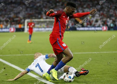 Daniel Sturridge (top) of England and Vladimir Weiss of Slovakia in Action During the Uefa Euro 2016 Group B Preliminary Round Match Between Slovakia and England at Stade Geoffroy Guichard in Saint-etienne France 20 June 2016 (restrictions Apply: For Editorial News Reporting Purposes Only not Used For Commercial Or Marketing Purposes Without Prior Written Approval of Uefa Images Must Appear As Still Images and Must not Emulate Match Action Video Footage Photographs Published in Online Publications (whether Via the Internet Or Otherwise) Shall Have an Interval of at Least 20 Seconds Between the Posting ) France Saint-etienne
