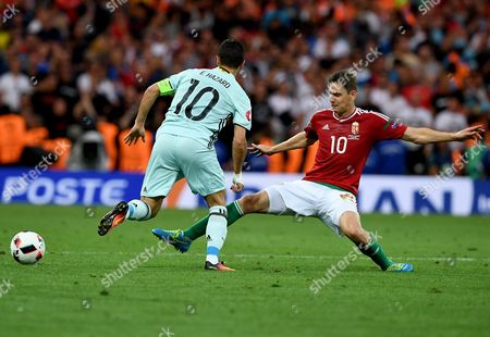 Zoltan Gera of Hungary (r) and Eden Hazard of Belgium in Action During the Uefa Euro 2016 Round of 16 Match Between Hungary and Belgium at Stade Municipal in Toulouse France 26 June 2016 (restrictions Apply: For Editorial News Reporting Purposes Only not Used For Commercial Or Marketing Purposes Without Prior Written Approval of Uefa Images Must Appear As Still Images and Must not Emulate Match Action Video Footage Photographs Published in Online Publications (whether Via the Internet Or Otherwise) Shall Have an Interval of at Least 20 Seconds Between the Posting ) France Toulouse