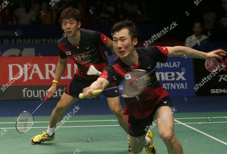 Korean Lee Yong Dae (l) and Yoo Yeon Seong (r) in Action Against Chai Biao and Hong Wei of China During Their Men's Double Final Match at the Bca Indonesia Open Badminton in Jakarta Indonesia 05 June 2016 Indonesia Jakarta