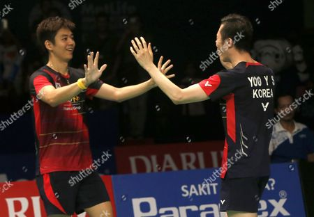 Korean Lee Yong Dae (l) and Yoo Yeon Seong (r) Jubilate After Defeating Chai Biao and Hong Wei of China During Their Men's Double Final Match at the Bca Indonesia Open Badminton in Jakarta Indonesia 05 June 2016 Indonesia Jakarta