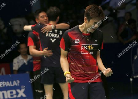 Stock Picture of Korean Lee Yong Dae (r) and Yoo Yeon Seong (l) Jubilate After Defeating Chai Biao and Hong Wei of China During Their Men's Double Final Match at the Bca Indonesia Open Badminton in Jakarta Indonesia 05 June 2016 Indonesia Jakarta
