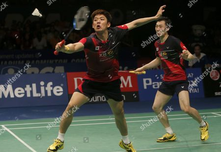 Stock Photo of Korean Lee Yong Dae (l) and Yoo Yeon Seong (r) in Action Against Chai Biao and Hong Wei of China During Their Men's Double Final Match at the Bca Indonesia Open Badminton in Jakarta Indonesia 05 June 2016 Indonesia Jakarta