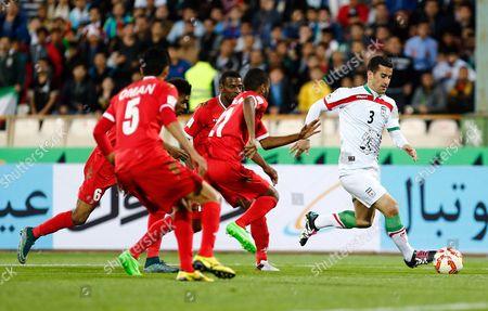 Iran's (r) Ehsan Hajsafi in Action Against Oman's Ahmed Mubarak (l) During the Fifa World Cup 2018 Asian Qualifying Soccer Match Between Iran and Oman at the Azadi Stadium in Tehran Iran 29 March 2016 Iran (islamic Republic Of) Tehran