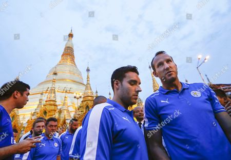 Leicester City's Australian Goalkeeper Mark Schwarzer (r) Midfielder Matty James (c) and Their Teammates During Their Visit to the Holy Shwedagon Pagoda in Yangon Myanmar 22 May 2016 Leicester City Owned by Thai Billionaire Vichai Srivaddhanaprabha Visited Myanmar's Holy Landmark Shwedagon Pagoda After Winning the English Premier League Title For the First Time in the Club's History Myanmar Yangon