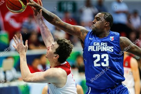 Stock Picture of Omer Asik (l) of Turkey in Action Against Andray Blatche (r) of the Philippines During a Friendly Basketball Game Between the Philippines and Turkey in Pasay City South of Manila Philippines 01 July 2016 the Game is the Last Preparation Game Before the 2016 Fiba Olympic Qualifying Tournament Which Runs From 05 to 10 July 2016 Philippines Manila