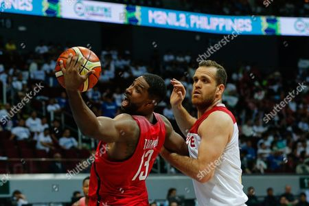Tristan Thompson (l) of Canada in Action Against Oguz Savas (r) of Turkey During the 2016 Fiba Olympic Qualifying Tournament Match Between Turkey and Canada at the Sm Mall of Asia Arena in Pasay City South of Manila Philippines 05 July 2016 the 2016 Fiba Olympic Qualifying Tournament Will Run From 05 to 10 July 2016 Philippines Manila