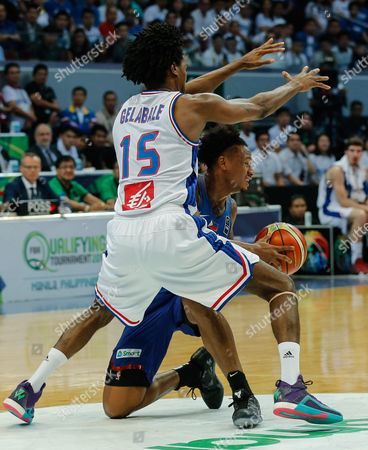 Bobby Ray Parks (r) of the Philippines in Action Against Mickael Gelabale (l) of France During the 2016 Fiba Olympic Qualifying Tournament Match Between France and the Philippines at the Sm Mall of Asia Arena in Pasay City South of Manila Philippines 05 July 2016 the 2016 Fiba Olympic Qualifying Tournament Will Run From 05 to 10 July 2016 Philippines Manila