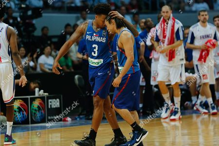 Bobby Ray Parks (l) and Terrence Romeo (r) of the Philippines React During Their Match Against France During the 2016 Fiba Olympic Qualifying Tournament Match Between France and the Philippines at the Sm Mall of Asia Arena in Pasay City South of Manila Philippines 05 July 2016 the 2016 Fiba Olympic Qualifying Tournament Will Run From 05 to 10 July 2016 Philippines Manila