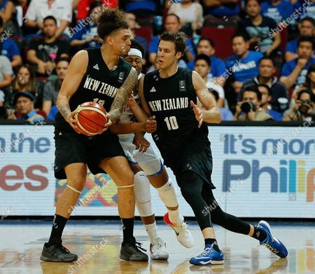Isaac Fotu (l) and Thomas Abercrombie (r) of New Zealand in Action Against Bobby Ray Parks (c) of the Philippines During the 2016 Fiba Olympic Qualifying Tournament Match Between the Philippines and New Zealand at the Sm Mall of Asia Arena in Pasay City South of Manila Philippines 06 July 2016 the 2016 Fiba Olympic Qualifying Tournament Will Run From 05 to 10 July 2016 Philippines Manila