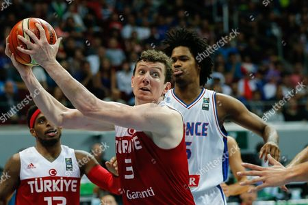 Omer Asik (c) of Turkey in Action Against Mickael Gelabale (r) of France During the 2016 Fiba Olympic Qualifying Tournament Semi Final Match Between France and Turkey at the Sm Mall of Asia Arena in Pasay City South of Manila Philippines 09 July 2016 Philippines Manila