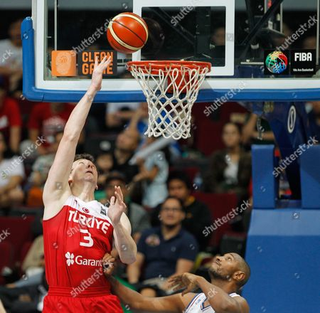 Omer Asik (l) of Turkey in Action Against Boris Diaw (r) of France During the 2016 Fiba Olympic Qualifying Tournament Semi Final Match Between France and Turkey at the Sm Mall of Asia Arena in Pasay City South of Manila Philippines 09 July 2016 Philippines Manila