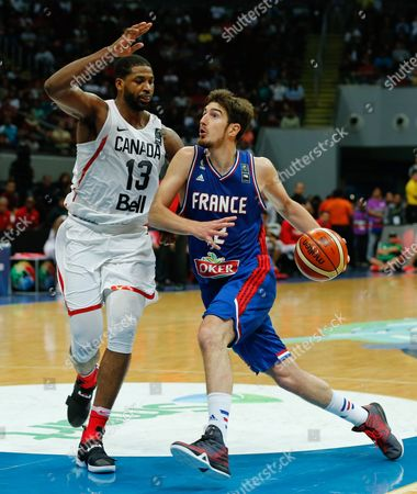 Nando De Colo (r) of France in Action Against Tristan Thompson (l)of Canada During the 2016 Fiba Olympic Qualifying Tournament Final Match Between Canada and France at the Sm Mall of Asia Arena in Pasay City South of Manila Philippines 10 July 2016 France Qualified to the 2016 Rio Olympics After Defeating Canada 83-74 Philippines Manila