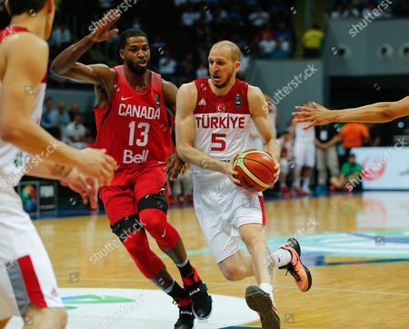 Sinan Guler (r) of Turkey in Action Against Tristan Thompson (l) of Canada During the 2016 Fiba Olympic Qualifying Tournament Match Between Turkey and Canada at the Sm Mall of Asia Arena in Pasay City South of Manila Philippines 05 July 2016 the 2016 Fiba Olympic Qualifying Tournament Will Run From 05 to 10 July 2016 Philippines Manila