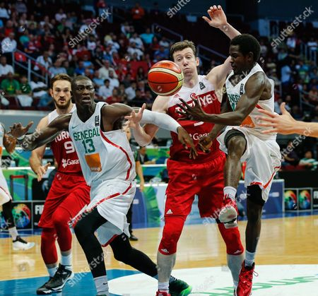 Stock Image of Serigne Gueye (r) and Hamady Ndiaye (2-l) of Senegal in Action Against Omer Asik (2-r) of Turkey During the 2016 Fiba Olympic Qualifying Tournament Match Between Senegal and Turkey at the Sm Mall of Asia Arena in Pasay City South of Manila Philippines 07 July 2016 the 2016 Fiba Olympic Qualifying Tournament Will Run From 05 to 10 July 2016 Philippines Manila