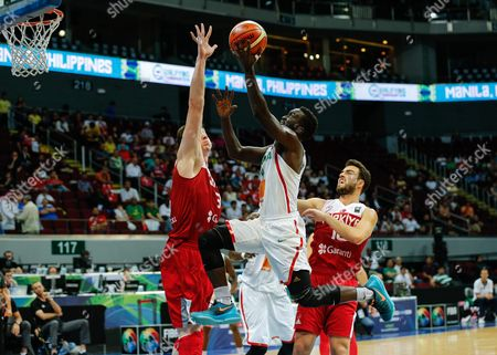 Thierno Niang (c) of Senegal in Action Against Omer Asik (l) and Melih Mahmutoglu (r) of Turkey During the 2016 Fiba Olympic Qualifying Tournament Match Between Senegal and Turkey at the Sm Mall of Asia Arena in Pasay City South of Manila Philippines 07 July 2016 the 2016 Fiba Olympic Qualifying Tournament Will Run From 05 to 10 July 2016 Philippines Manila
