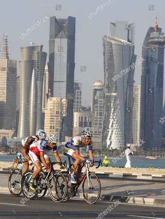 Stock Image of French Rider Steven Tronet (c) of Fortuneo Vital Concept Team New Zealand's Jesse Sergent (l) of Ag2r La Mondiale Team and Belgian Rider Tim Declercq (r) of Topsport Vlaanderen Baloise Team in Action During the 5th and Final Stage of the Tour of Qatar 2016 Over 114 5km From Sealine Beach to Doha Qatar 12 February 2016 Qatar Doha