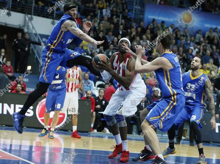 Josh Boone (l) Stanislav Ilnitskiy (2nd-r) Tyler Honeycutt (r) of Khimki Moscow Fight For a Ball with Hakim Warrick (c) of Olympiacos Piraeus During the Basketball Euroleague Top 16 Group F Match Held Between Khimki Moscow and Olympiacos Piraeus in Moscow Russia 31 March 2016 Russian Federation Moscow