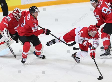 Goalkeeper Reto Berra (l) Felicien Du Bois (2-l) and Samuel Walser (r) of Switzerland in Action Against Frederik Storm (c) of Denmark During the Ice Hockey World Championship 2016 Preliminary Round Match Between Switzerland and Denmark at the Ice Palace in Moscow Russia 10 May 2016 Russian Federation Moscow